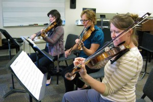 Music students playing instruments